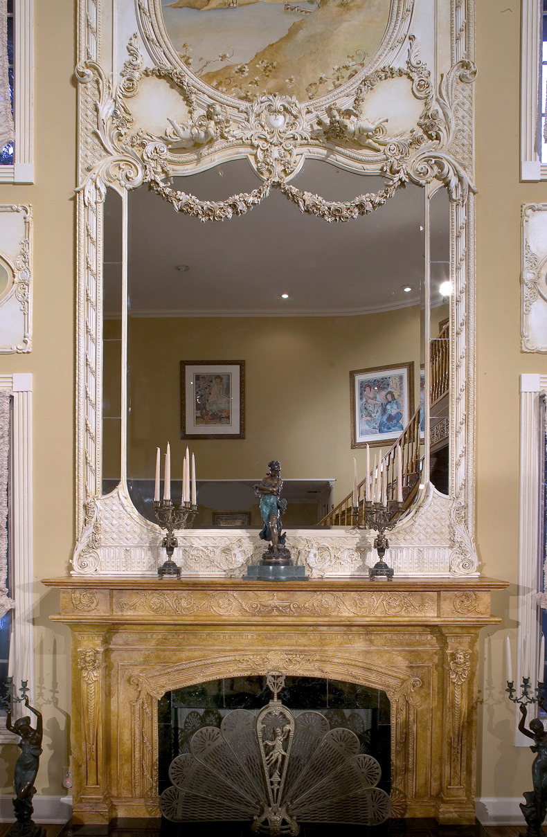 Mirrored over=mantel with hand painted trumeau