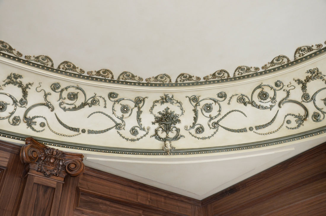 Original design of hand fabricated ceiling cove in library