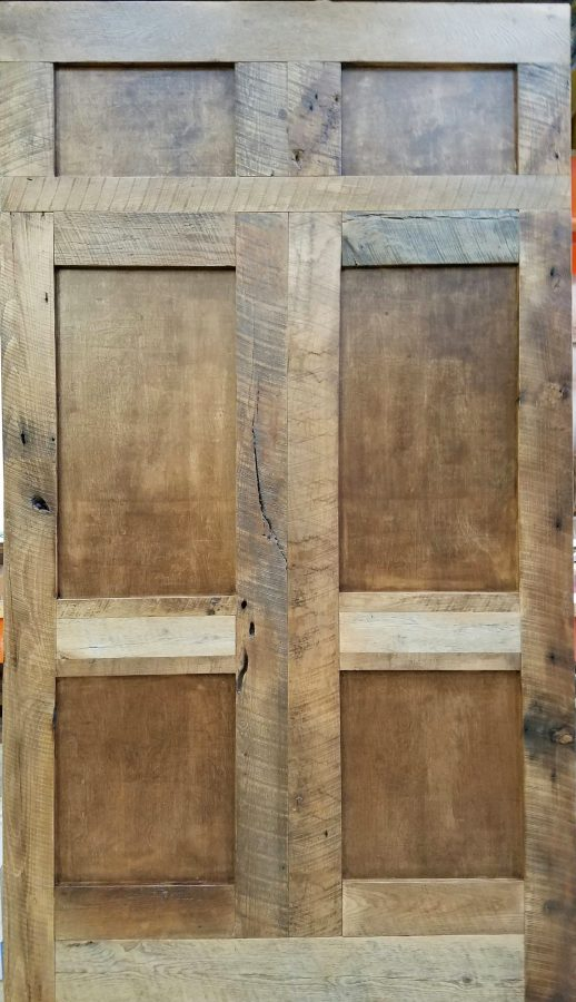 Custom designed Barn Doors with reclaimed wood and hand fabricated original panel inlay